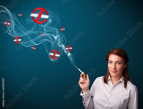 Young woman smoking dangerous cigarette with no smoking signs