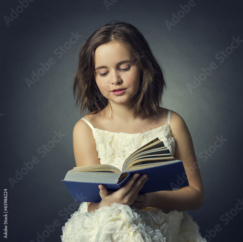 Teen girl reading the book on a black background