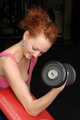 Slim girl doing biceps traning