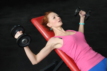 Young girl doing Dumbbell Incline Bench Press workout