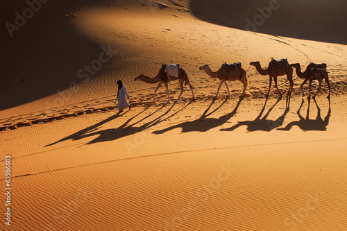 Desert Sahara, Camel Ride Caravan, Enjoying and happy People - 63986683