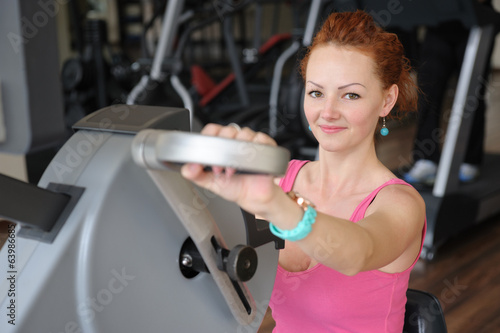 girl doing hands spinning machine workout
