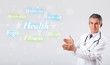 canvas print picture - Clinical doctor pointing to health and fitness collection of wor