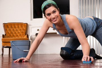 Adorable Housewife Doing Cleaning Chores Scrubbing Wood Floor