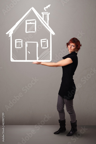 Young lady holding a huge drawn house