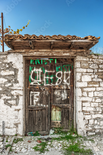 Weathered house wooden door in Berat, Albania.NEF