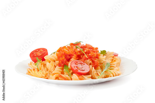 Pasta with cherry tomatoes and arugula leaves