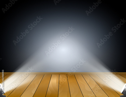 Dark background with spotlights or projection lamps.