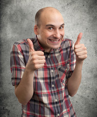 Funny guy showing his thumbs up