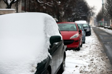Cars covered in snow after blizzard