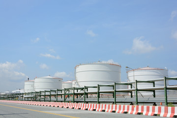 row of large white tanks for petrol and oil in Thailand