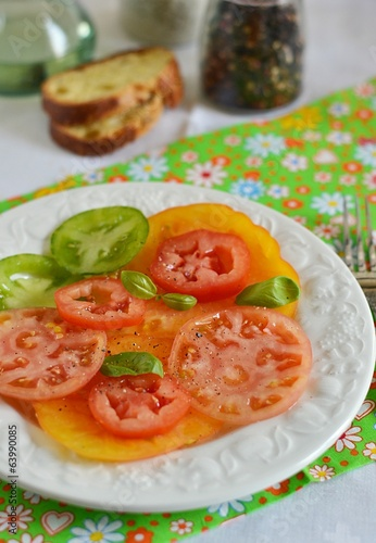 Tomato salad with oil, pepper, salt for dinner