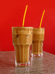Two glasses of ice-cold frappe coffee