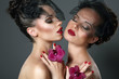 Couple of Tempting Passionate Women with Flowers Flirting