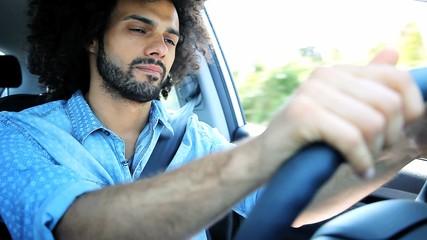 Serious sad angry man driving car