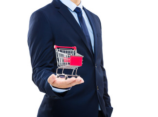 Businessman holding shopping cart