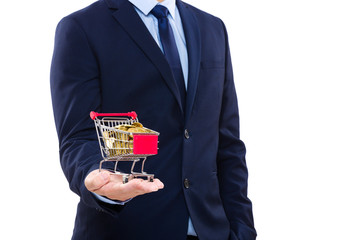 Businessman holding shopping cart with gold coin