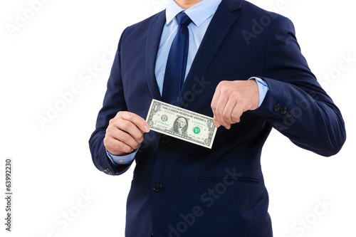 Part of body for businessman holding one dollar