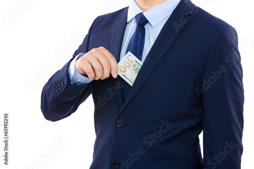 Businessman taking out money from pocket