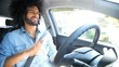 Happy man singing and dancing while driving car