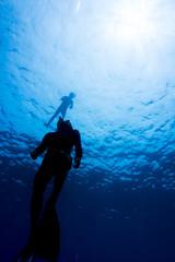 Freediver dives at Surin island, Thailand