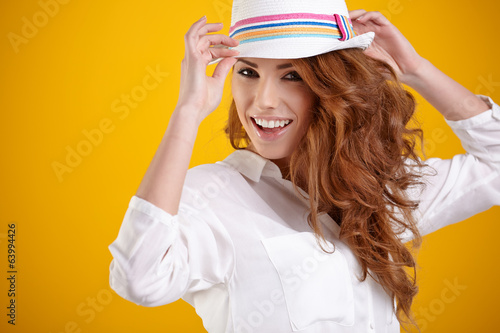 Fashion portrait of pretty woman wearing stylish hat. Young Cauc