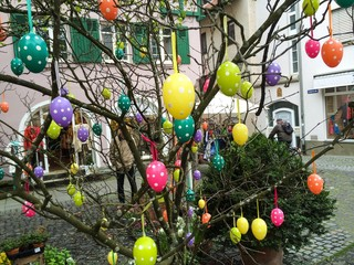 Colorful easter eggs in city