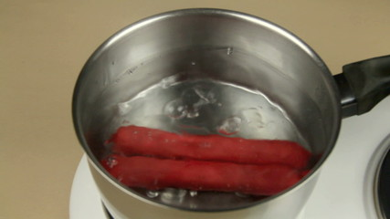 Frankfurters put in a pot of boiling water