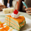 canvas print picture - Orange  crepe cake