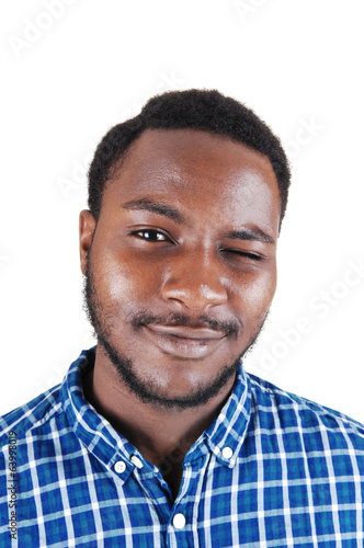 Black man blinking with his eye.