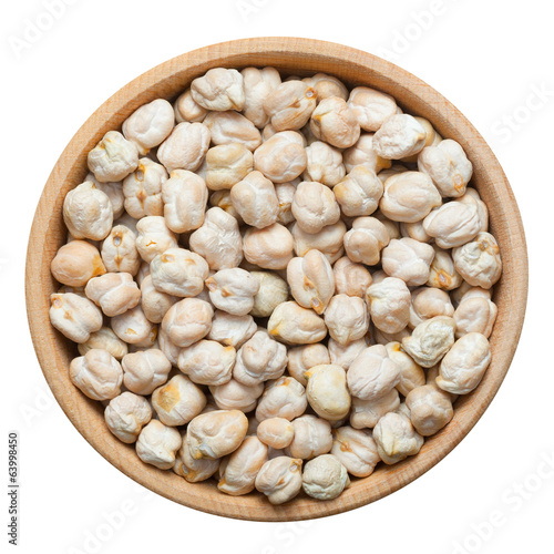 Chick peas in wooden bowl, isolated on white