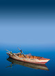 Fishing boat in the sea - 63999687
