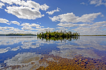 Sunny Reflections on a Clear Lake