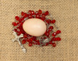 egg and red beads