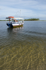 Brazilian Boat Anchored in Shallow Water