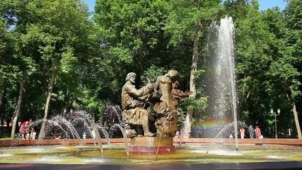 fountain creating a colorful rainbow