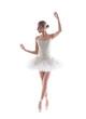 Elegant young ballerina isolated on white backdrop