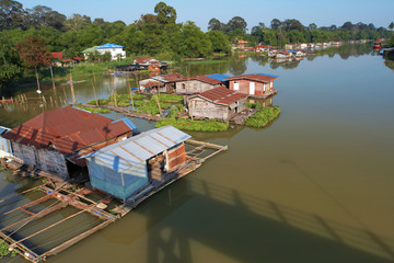 house boat on river in thailand