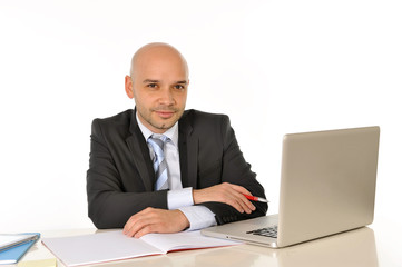young bald attractive business man with computer at work