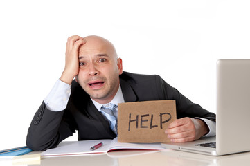 bald latin business man overworked holding help sign
