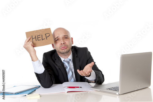 bald latin business man  in stress with computer