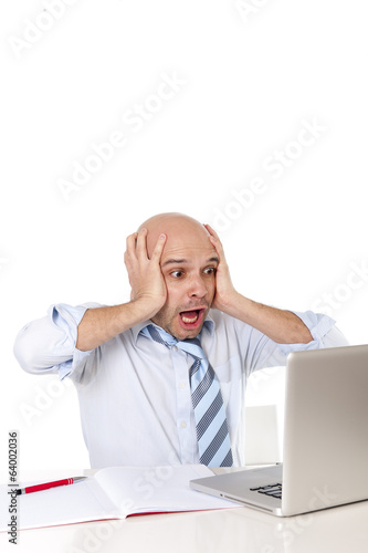 bald latin business man screaming at computer in stress at work