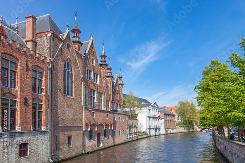 Canal in Bruges with an ancient red brick building