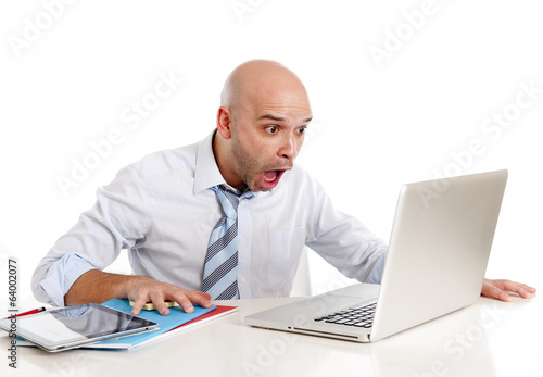 bald latin businessman screaming at computer in stress