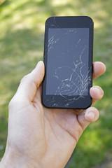 smartphone with broken screen in the hand
