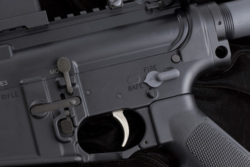carbine on black - partial view