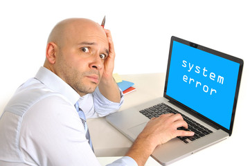 worried young business man technical problem at computer