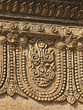 old bas-relief with mythical ornament on the ancient temple