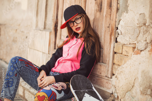 hipster young girl listen music from smartphone