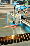 Laser or plasma cutting of metal sheet with sparks
